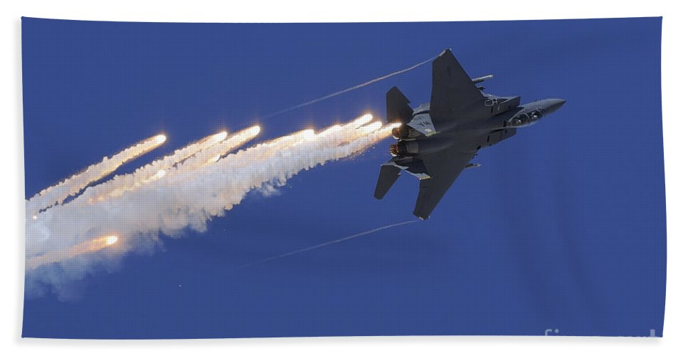 Horizontal Bath Sheet featuring the photograph An F-15e Strike Eagle Releases Flares by Remo Guidi