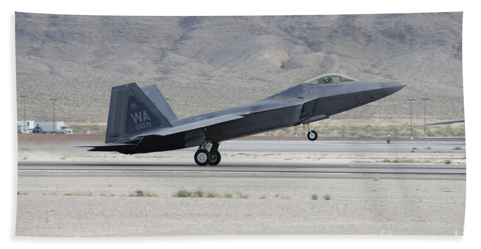 Horizontal Bath Sheet featuring the photograph An F-22 Raptor Landing On The Runway by Remo Guidi