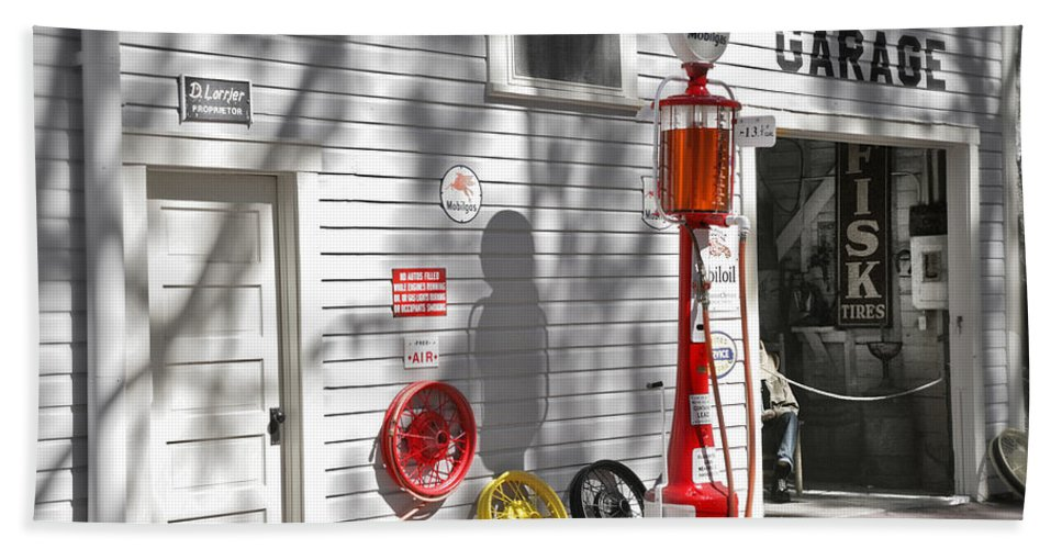 Garage Bath Sheet featuring the photograph An Old Village Gas Station by Mal Bray