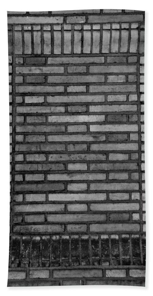Scenic Hand Towel featuring the photograph Another Brick In The Wall In Black And White by Rob Hans
