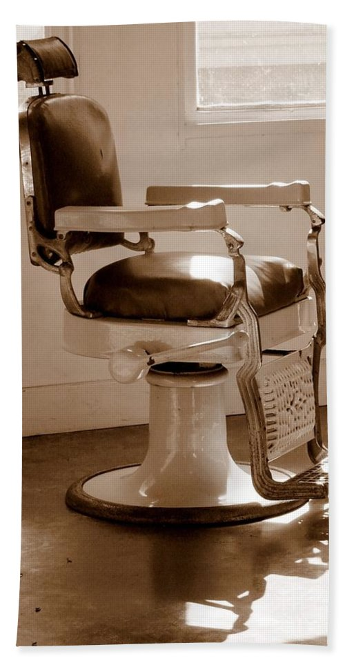 Sepia Hand Towel featuring the photograph Antiquated Barber Chair In Sepia by Mary Deal