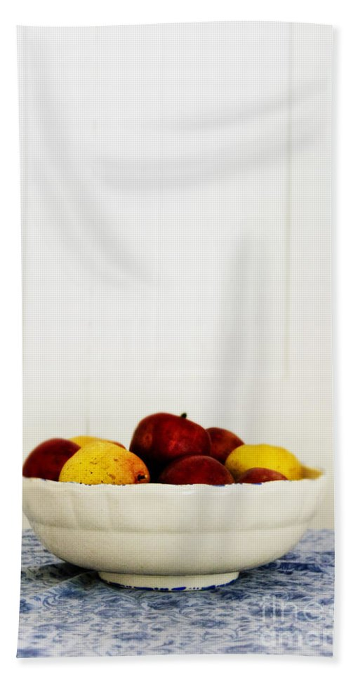 Fruit; Bowl; Still Life; Table; Table Cloth; Bowl Of Fruit; Fresh; Food; Kitchen; Old; Apples; Red; Yellow; Inside; Indoors; White; Blue; Minimal; Minimalism; Wall; Wood Bath Sheet featuring the photograph Apples by Margie Hurwich