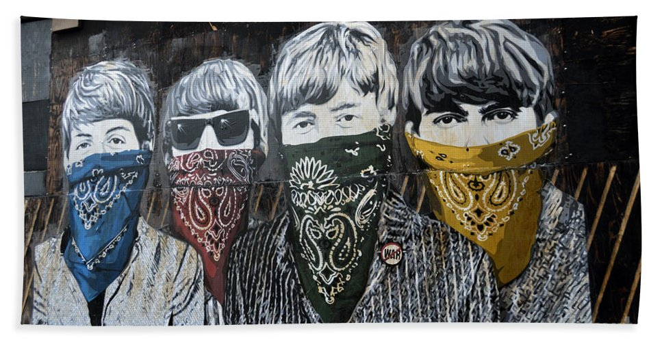 Banksy Bath Towel featuring the photograph The Beatles wearing face masks street mural by RicardMN Photography