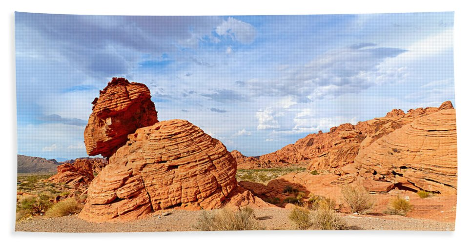 Beehive Bath Towel featuring the photograph Beehive rock formation under a stormy sky in Nevada Valley of Fire State Park by Jamie Pham