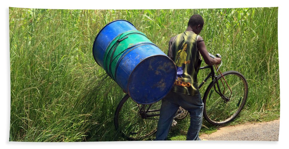 Africa Hand Towel featuring the photograph Bicycle Strain by Aidan Moran