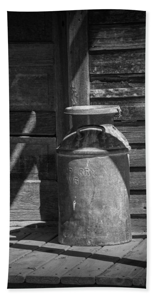 Creamery Can Bath Sheet featuring the photograph Black And White Photograph Of Vintage Creamery Can By The Old Homestead In 1880 Town by Randall Nyhof