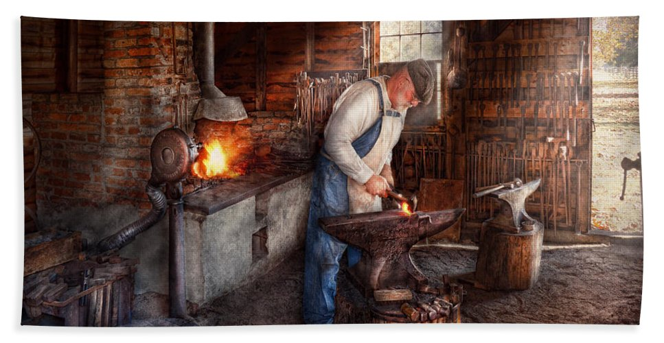 Blacksmith Hand Towel featuring the photograph Blacksmith - The Smith by Mike Savad