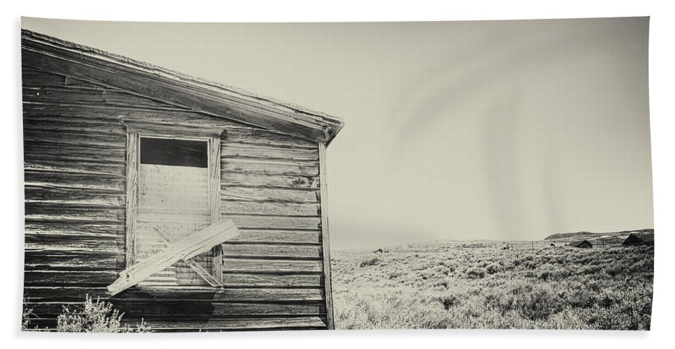 Structure; Wood; Wooden; Country; Countryside; Desert; Deserted; Worn; Abandoned; Boards; Ruins; Boarded Up; Grasses; Hills; House; Home; Sepia; Rural; Vast; Dirt; Window; Sky; Vintage; Antique Hand Towel featuring the photograph Boarded by Margie Hurwich