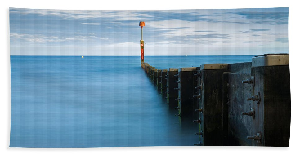Bournemouth Hand Towel featuring the photograph Bournemouth Groyne At Sundown by Ian Middleton