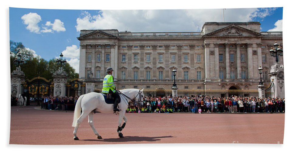 London Bath Sheet featuring the photograph British Royal Guards Riding On Horse And Perform The Changing Of The Guard In Buckingham Palace by Michal Bednarek