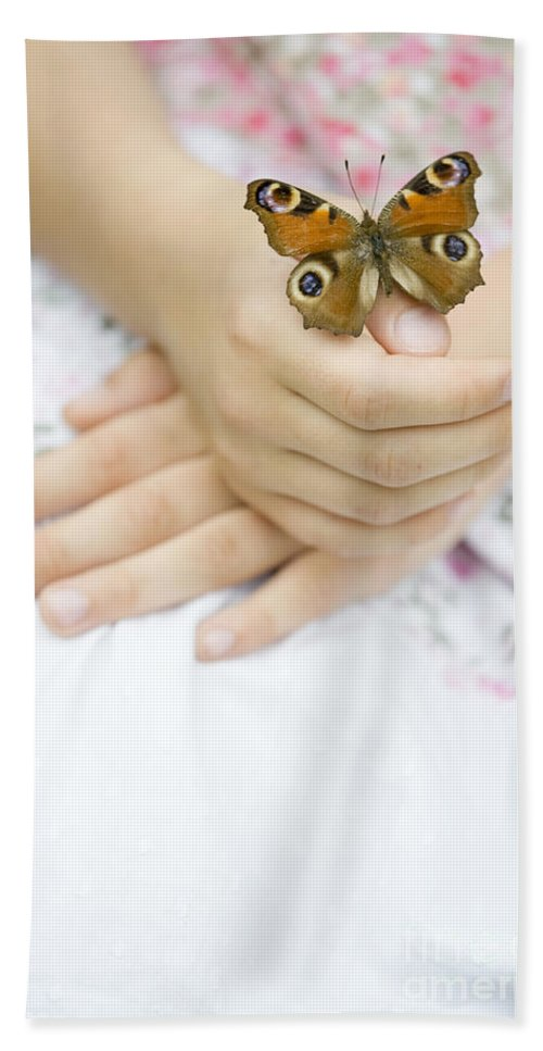 Butterfly Hand Towel featuring the photograph Butterfly Resting On A Girls Hand by Lee Avison
