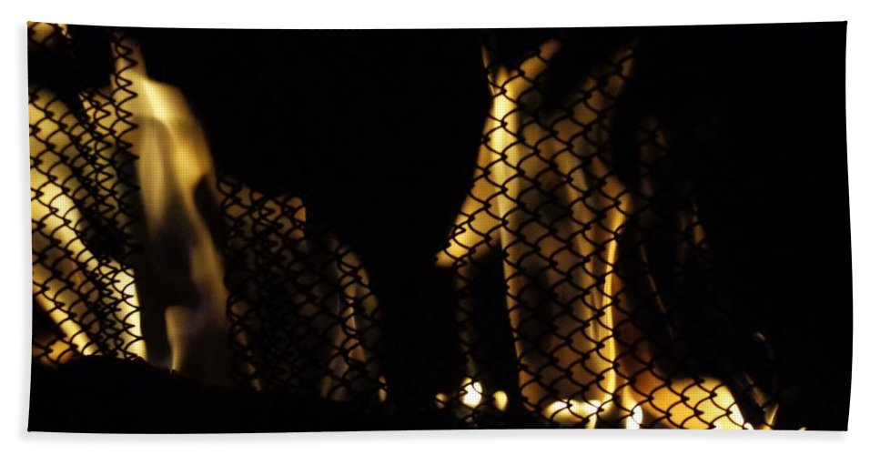 Fire Hand Towel featuring the photograph Caged Fire by Jannice Walker