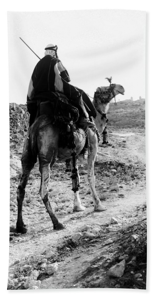 Camel Hand Towel featuring the photograph Camel Rider by Munir Alawi