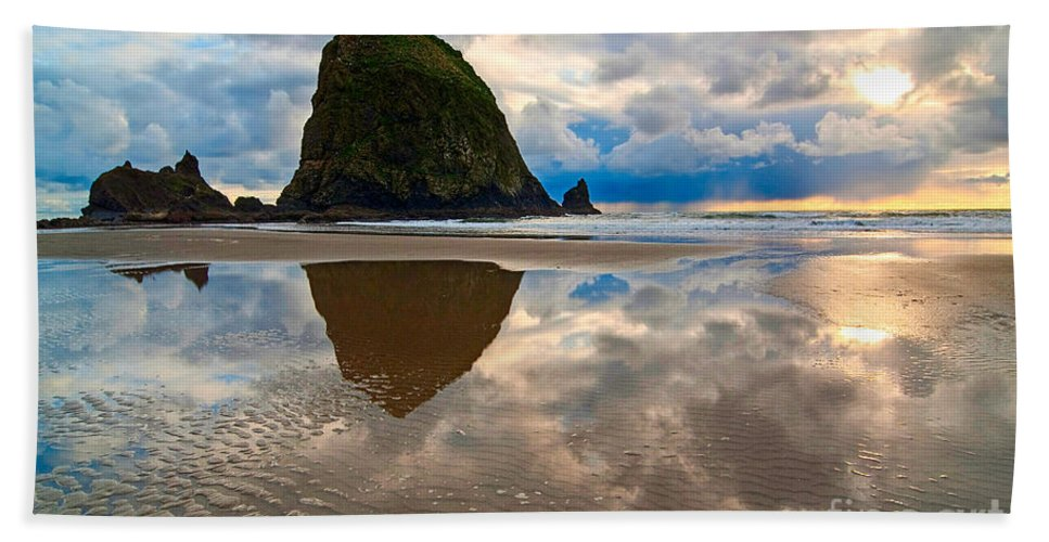 Cannon Beach Bath Sheet featuring the photograph Cannon Beach With Storm Clouds In Oregon Coast by Jamie Pham
