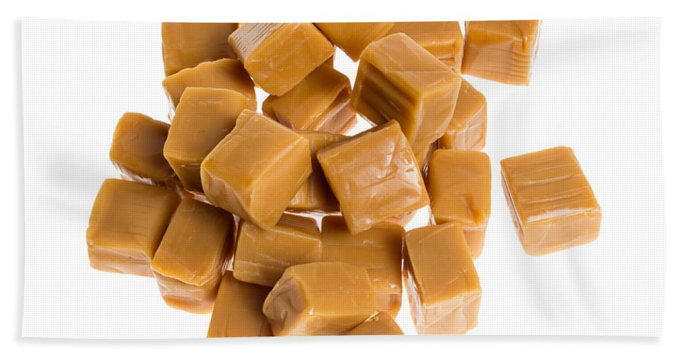 Food Hand Towel featuring the photograph Caramel Cubes by John Trax