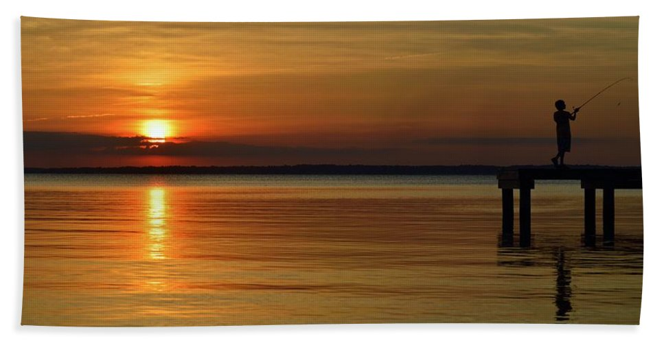 Beach Bum Pics Bath Sheet featuring the photograph Cast Away - Young Child Fishing From A Pier On The Indian River Bay As The Sun Sets Across The Water by William Bartholomew
