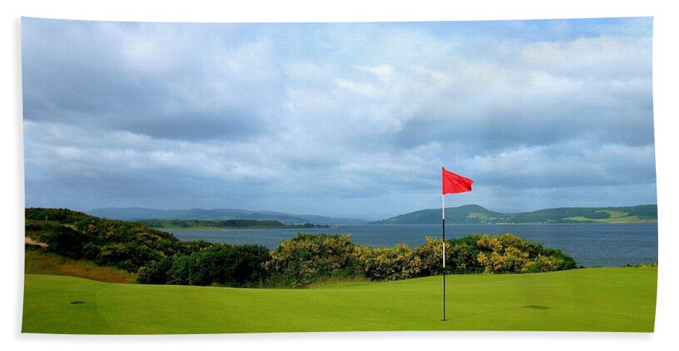 Castle Stuart Golf Links Scotland Firth Green Gorse Blooming Image Picture Photo Photograph Inverness United Kingdom Pin Flag Red Water Blue Putting Surface Scottish Open 2013 Club Print Prints Scotland Shot Fine Art Print For Sale Highlands British Open Phil Mickleson Ninth Green 9th Par Four 4 Clouds Sky Blue Firth Forth St. Nairn North  Hand Towel featuring the photograph Castle Stuart Golf Links by Scott Carda