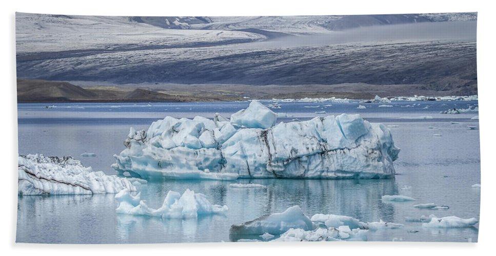 Jokulsarlon Bath Towel featuring the photograph Chasing Ice by Evelina Kremsdorf