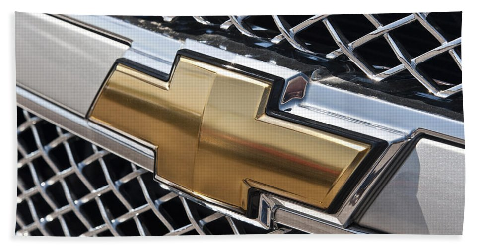 Chevrolet Hand Towel featuring the photograph Chevrolet Bowtie Symbol On Chevy Silverado Grill E181 by Wendell Franks