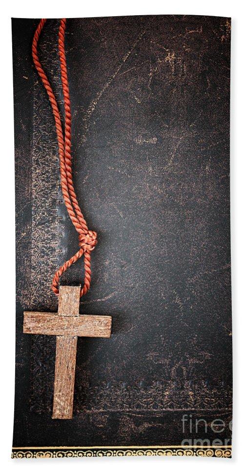 Cross Bath Sheet featuring the photograph Christian Cross On Bible by Elena Elisseeva