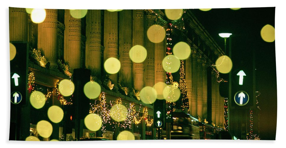 London; Decorations; Selfridges; Department Store; Night; Winter; Glowing; Lights; Fancy; Street; Nighttime; City; Holiday; Spirit; Festive; Shopping; Photograph; Motion; Light; Cold; Wintry; Season; Seasonal; Streetlight; Streetlights; Decoration; Street Scene; Scene; Empty; Lit Up; Excitement; Pretty Hand Towel featuring the photograph Christmas Lights In Oxford Streeet by Unknown Photographer