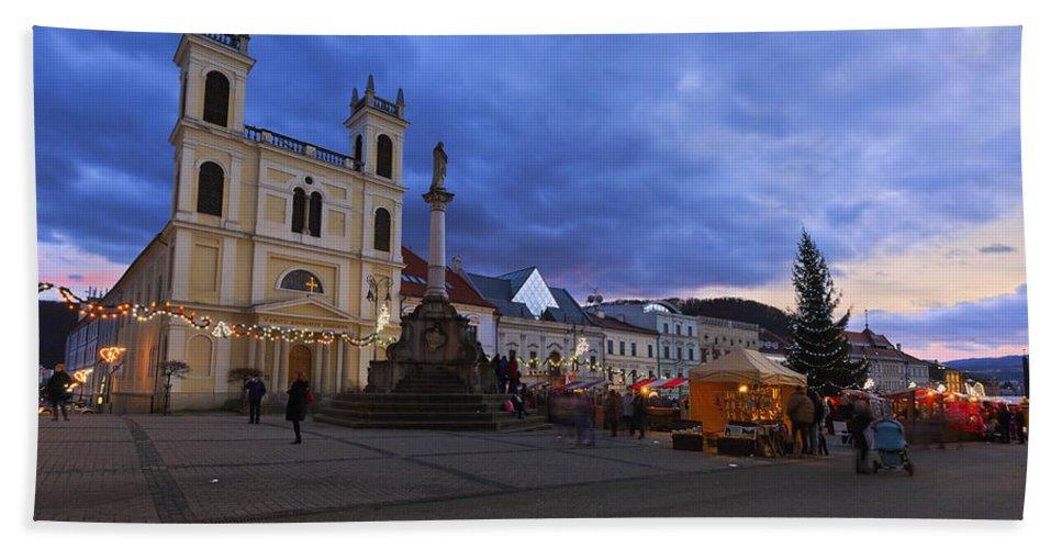 Slovakia Bath Sheet featuring the photograph christmas market in Banska Bystrica by Milan Gonda