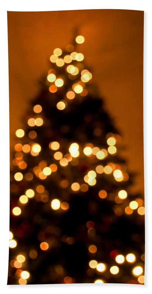 Christmas Hand Towel featuring the photograph Christmas Tree Bokeh by Photos By Cassandra