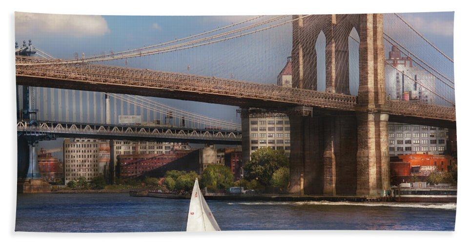 Savad Bath Sheet featuring the photograph City - Ny - Sailing Under The Brooklyn Bridge by Mike Savad