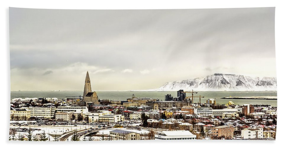 Above Hand Towel featuring the photograph City Of Reykjavik by Maria Coulson