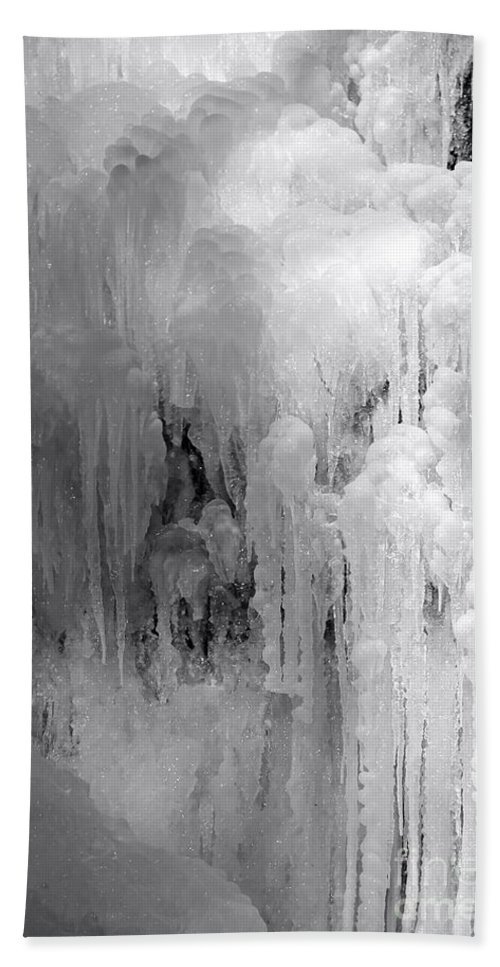 Ice Hand Towel featuring the photograph Closeup Of Icy Waterfall - Black And White by Carol Groenen