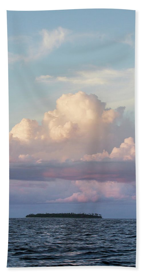 Cloud Hand Towel featuring the photograph Clouds Glow In The Sky During Sunset by Eyeconic Images