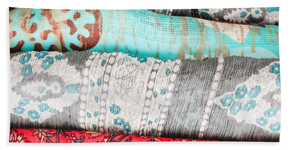 Africa Hand Towel featuring the photograph Colorful Cloths by Tom Gowanlock