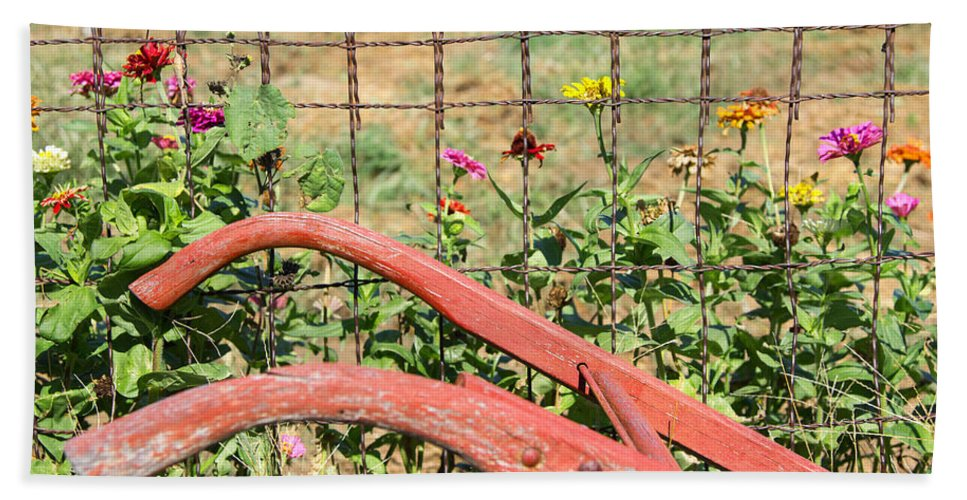 Zinnias Bath Sheet featuring the photograph Colorful Fence Row by Deb Buchanan