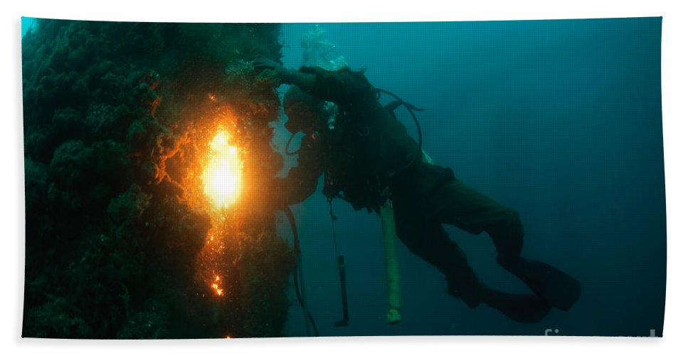 Commercial Diver Hand Towel featuring the photograph Commercial Diver At Work by Hagai Nativ