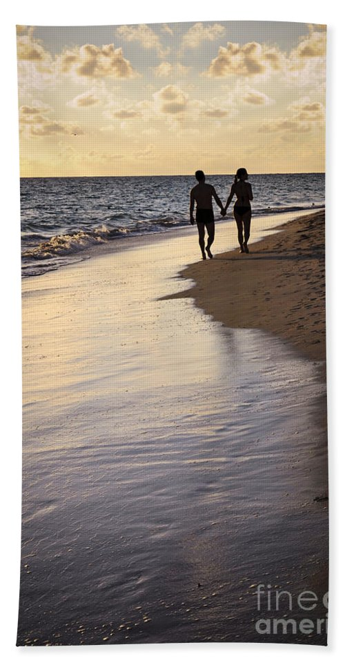Couple Bath Sheet featuring the photograph Couple Walking On A Beach by Elena Elisseeva