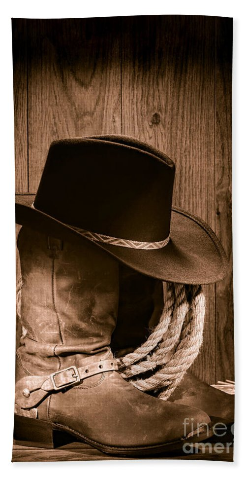 Boots Hand Towel featuring the photograph Cowboy Hat And Boots by Olivier Le Queinec