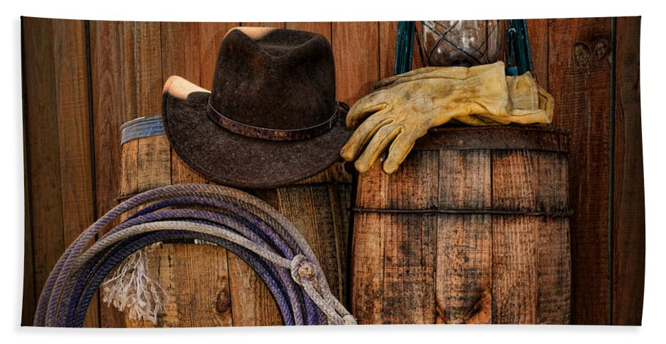 ff1c886b553 Barn Hand Towel featuring the photograph Cowboy Hat And Bronco Riding Gloves  by Paul Ward