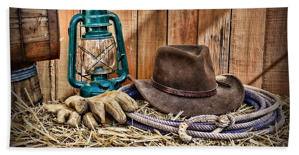 18dcda9306e Barn Hand Towel featuring the photograph Cowboy Hat And Rodeo Lasso by Paul  Ward