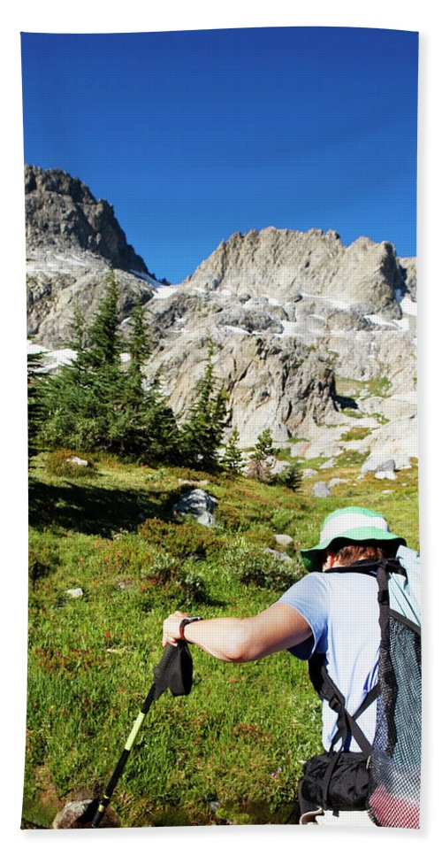 Active Hand Towel featuring the photograph Cropped Rear View Of A Female Hiker by Ron Koeberer