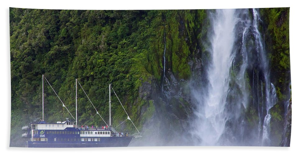 Milford Sound Hand Towel featuring the photograph Cruising By A Waterfall by Stuart Litoff