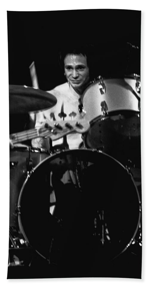 Denny Carmasi Bath Sheet featuring the photograph Denny Carmasi On The Drums In 1978 by Ben Upham