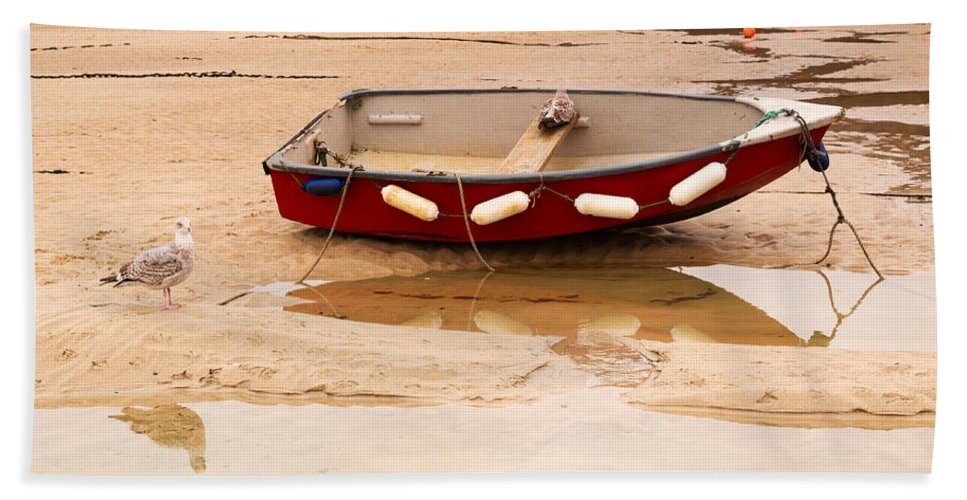 Beached Dinghy Bath Sheet featuring the photograph Dinghy At Low Tide In St Ives Cornwall by Louise Heusinkveld