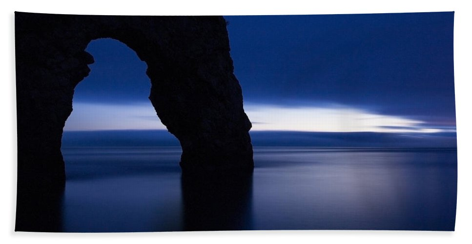 Durdle Bath Sheet featuring the photograph Durdle Door At Dusk by Ian Middleton