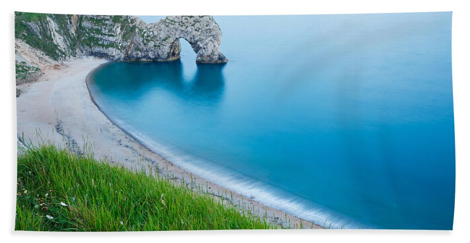 Durdle Hand Towel featuring the photograph Durdle Door In The Evening by Ian Middleton