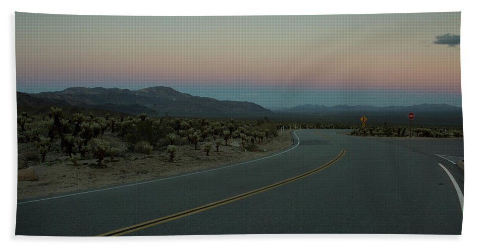Nobody Bath Sheet featuring the photograph Empty Road In Desert At Sunset by Natasha Shapiro