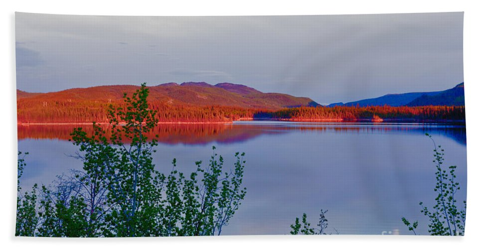 Adventure Hand Towel featuring the photograph Evening Sun Glow On Calm Twin Lakes Yukon Canada by Stephan Pietzko