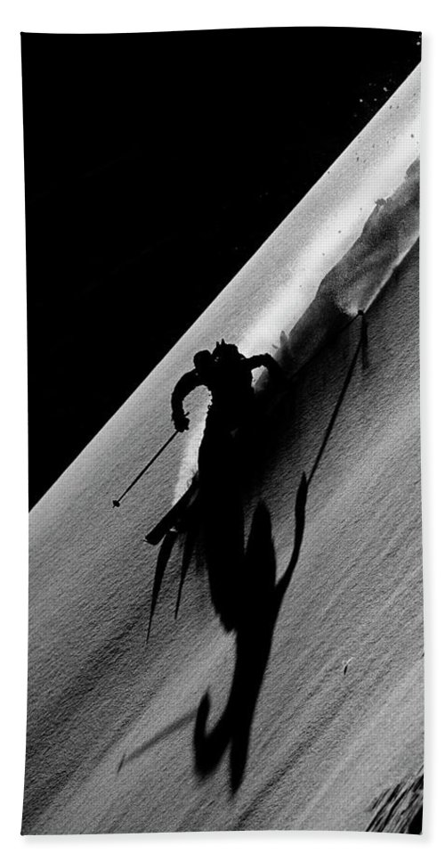 Action Bath Towel featuring the photograph Extreme Skier Turning Hard In Backlit by Patrik Lindqvist