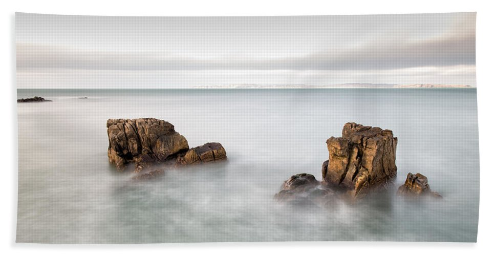 Pans Rock Hand Towel featuring the photograph Ballycastle - Face In The Rock by Nigel R Bell