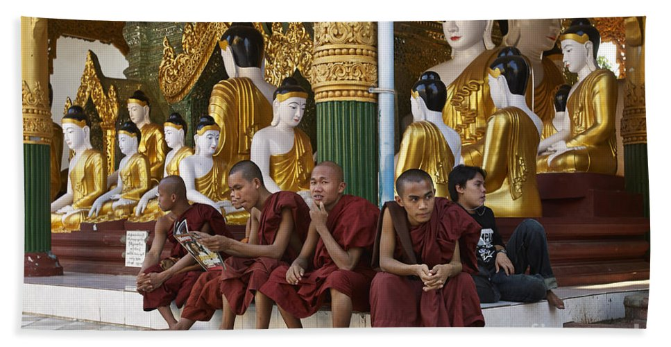 Myanmar Bath Sheet featuring the photograph faithful Buddhist monks siiting around Buddha Statues in SHWEDAGON PAGODA by Juergen Ritterbach