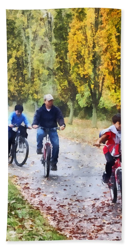 Autumn Bath Sheet featuring the photograph Family Bike Ride by Susan Savad